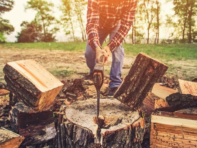Man Splitting Wood
